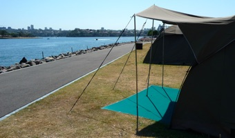Tents overlooking Sydney Harbour for 'glamping' on Cockatoo Island during the Sydney Biennale