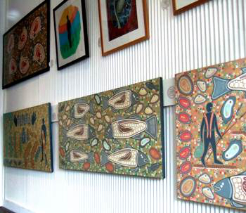 Aboriginal art and crafts paintings on the gallery wall