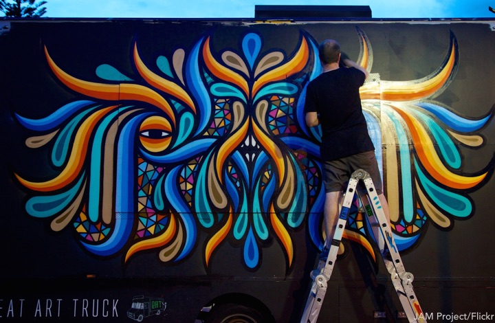 Sydney Art month: Beastman finishing up his painting of the Eat Art Truck at Victoria Park opposite the Seymour Centre on City Road just before 8.