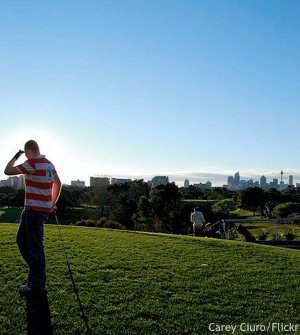 Cheap golf vacation: Golfer with the city in the distance