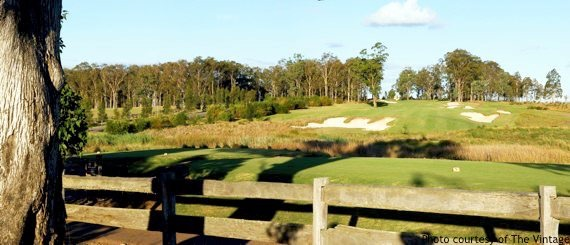 Golf Sydney: country course with wooden railings and trees