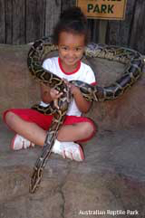 Reptile gardens: photo of a young girl with a big snake