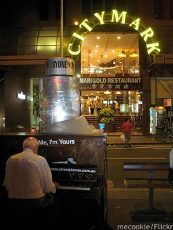 Sydney Festival: man playing a piano in the street