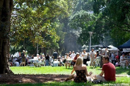 Sitting on the grass in dappled shade during the Food and Wine Festival Sydney