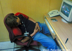 Person asleep in front of a computer: working holiday visa Australia
