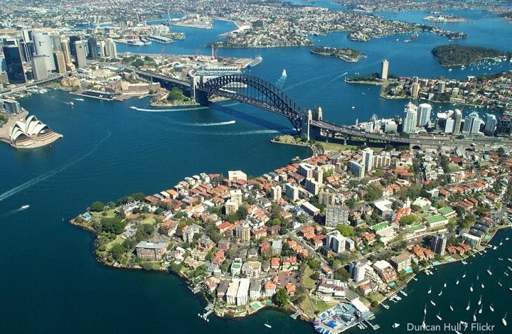 Cheapest flights to Sydney: Coming in over the harbour, Opera House and bridge below