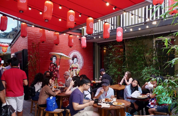 Cheap eats in Spice Alley: visitors enjoying casual, south-east Asian food at outside tables at this central location