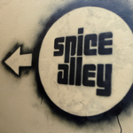 Spice Alley sign, the arrow leads to the cheap eats