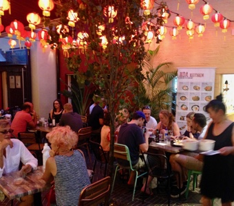 Evening cheap eats under the lanterns at Spice Alley.