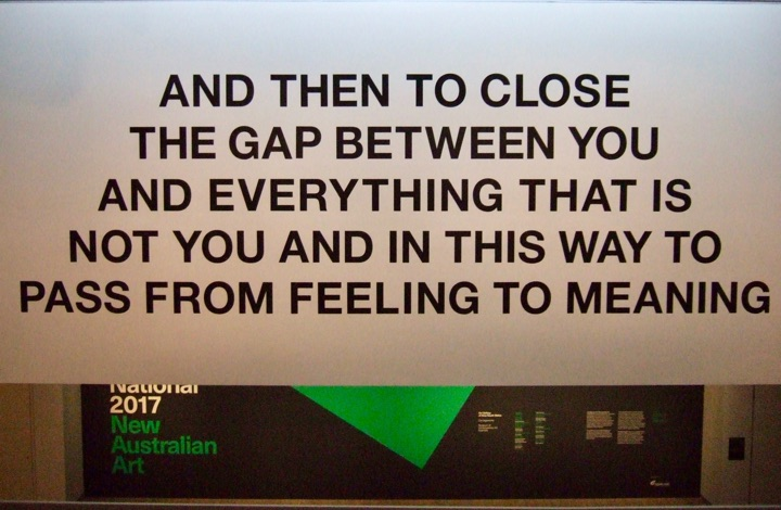 "Australian artwork, reads: ""And then to close the gap between you and everything that is not you and in this way to pass from feeling to meaning"""
