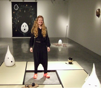 Artist Nell surrounded by her Australian artwork at the MCA
