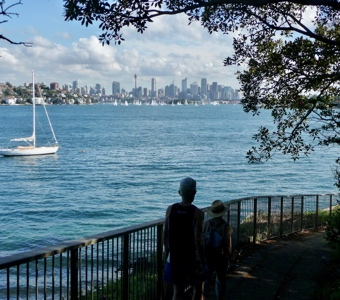 Sydney harbour walks: two walkers following the track with the city and harbour in the background