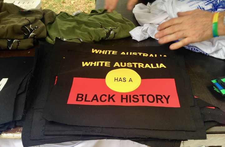 Sydney walks: Aboriginal flag with message: White Australia has a Black History