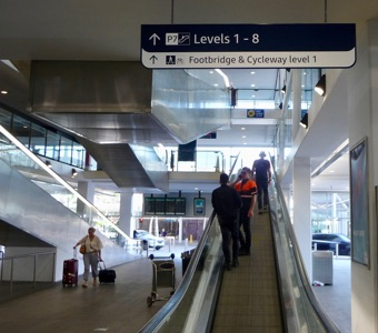 Going up to level 1 for the footbridge and cycleway which avoids airport fees on Sydney trains