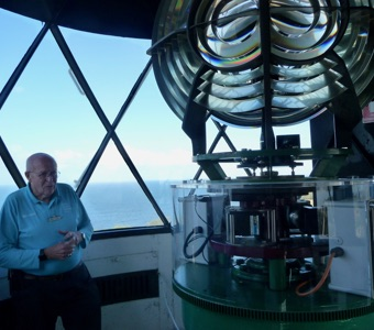 Volunteer tour guide inside the lighthouse, stunning Sydney view from the window