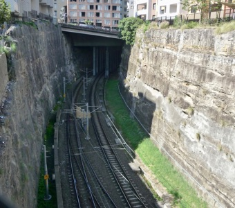 Things to see in Sydney: A cutting through sandstone rock, today used for railway lines